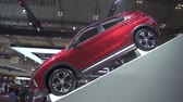 дилер : JAKARTA, Indonesia - July 23, 2019: Side view of New Mitsubishi Eclipse Cross car showed in GAIKINDO Indonesia International Auto Show (GIIAS) 2019 at Indonesia Convention Exhibition (ICE) Стоковые видеозаписи