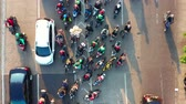 motosiklet : JAKARTA, Indonesia - July 30, 2019: Top down view of crowded motorcycle and cars moving at traffic jam on highway. Shot in 4k resolution from a drone flying forwards