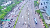 JAKARTA, Indonesia - January 27, 2020: Aerial view of tollway during rush hour with cars queuing on traffic jam.