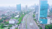 JAKARTA, Indonesia - January 27, 2020: Aerial landscape of tollway during rush hour with cityscape background