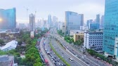 JAKARTA, Indonesia - January 27, 2020: Aerial time lapse of vehicle moving on traffic jam with cityscape background Archivo de Video