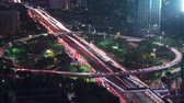 JAKARTA, Indonesia - January 28, 2020: Beautiful timelapse of light trails on Semanggi bridge and skyscrapers view at night time in Jakarta city. Shot in 4k resolution