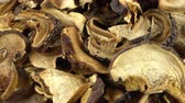 fungi : Close up of dried mushrooms ratating on parchment. Seamless loopable. Stock Footage