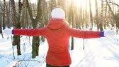 weather : Attractive young woman dancing silly and funny in winter park, having fun, smiling. Slow motion. Stock Footage