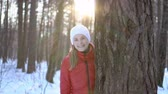śnieżka : Beautiful young woman in the winter park, having fun, smiling. Slow motion video.