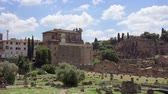 imperial : Exterior of ancient ruins Forum Romanum. Roman forum in center of Rome, Italy. Historical european architecture. Columns and stones of old monument in slow motion. Unrecognizable people in distance Stock Footage