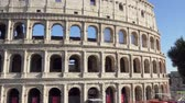 koloseum : ROME, ITALY - CIRCA May 2018: Famous Italian attraction Colosseum in Rome. Veiw on ancient Flavius amphitheater Coliseum in capital of Italy. Tourists walking around Wideo