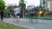 lumpini : BANGKOK, THAILAND - CIRCA March 2017: Timelapse of people running in Lumpini park in Bangkok, Thailand at evening Stock Footage