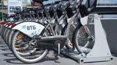 bell : MOSCOW, RUSSIA- CIRCA August 2018: VTB bicycle parking in Moscow. Gray city bikes parked on street. Hand-held camera