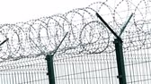 forbidden : Security fence with a barbed wire. Fence with a barbed wire. Stock Footage