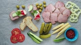 crumpled : Cold appetizer. Cold cuts. Different snacks on a white crumpled paper, from above.