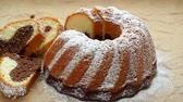 stirred : Traditional homemade marble cake. Sliced marble bundt cake on paper.