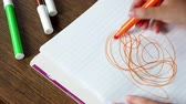 sheets : Child draws picture on paper, 4k resolution Stock Footage