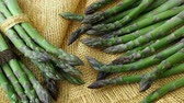 officinalis : Bunches of asparagus tied with twine on a burlap background. Asparagus officinalis.