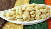 juta : Uncooked homemade potato gnocchi in a white bowl