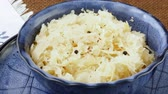 braised dishes : Sauerkraut in a blue bowl. Fresh healthy sauerkraut.