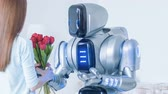 invent : Modern robot presenting flowers to a nice woman