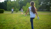 voluntário : Energetic young volunteers running in park while cleaning garbage there