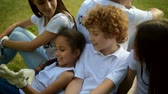 voluntário : Adorable kids having rest after working with volunteers
