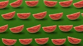 segmento : Colorful fruit pattern of fresh watermelon slice on green background. 4k video. Vídeos