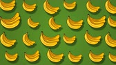 art product : Colorful yellow banana pattern on green background. 4k video. Stock Footage