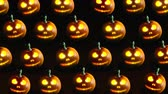 abóboras : Group of Halloween Jack o Lanterns on dark background. 4k video.