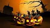 ogień : Group of Halloween Jack o Lanterns on cemetery background