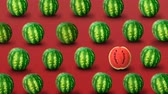 outstanding : Colorful fruit pattern of fresh watermelons on red background. Individuality, independence and uniqueness concept.