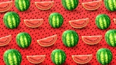 произведение искусства : Fresh watermelons on red background. Colorful fruit pattern. 4k video.