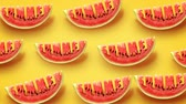 резной : Fresh slices of watermelon on yellow background. Word Summer carved in every piece.