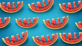 sleva : Fresh slices of watermelon on blue background. Word SALE carved in every piece.