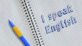 lehre : Text I speak English hand written on sheet of notebook and animated. Stock Footage