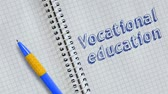caligrafia : Text Vocational education handwritten on sheet of notebook and animated. Vídeos