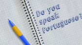 memorando : Do you speak Portuguese? Text handwritten on sheet of notebook and animated. Vídeos
