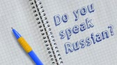 hand written : Do you speak Russian? Text handwritten on sheet of notebook and animated.