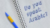 escrita : Do you speak Arabic? Text handwritten on sheet of notebook and animated.