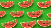 melão : Fresh slices of watermelon on green background. Word Summer carved in every piece.