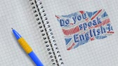 pero : Hand drawing and animated British flag with text Do you speak English? on sheet of notebook Dostupné videozáznamy