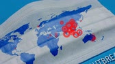 população : Covid-19 outbreak. Medical mask with World map. Concept of the spread of the coronavirus on the planet. Stock Footage