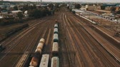 Railway yard with a lot of railway lines and freight trains. Aerial