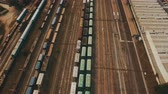 Railway yard with a lot of railway lines and freight trains. Aerial footage