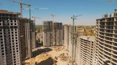 betoniarka : Construction of houses. Drone fly over construction site with tower cranes Wideo