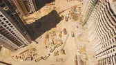 contramestre : Construction of houses. Drone fly over construction site with tower cranes Stock Footage
