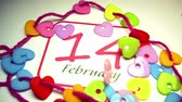 varal : February 14 covered with colored plastic hearts, Valentines Day background