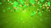 трилистник : Falling clover leaves on green radial background. Saint Patricks day (St Patricks) holiday background. Seamless loop. Different colors background is available.