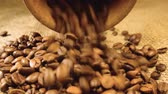 makro : Coffee grains are poured from wooden containers