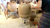 aletsiz : Feb 18, 2017 - Ratchaburi, Thailand: female worker draws lines by freehands on clayed jar, one of making famous Dragon Jar of Ratchaburi pottery industry.