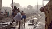 group of children : VRINDAVAN, India - October 10, 2017: Indian children and adolescents are washed in the street along the way. Vrindavan. India. For editorial use only.