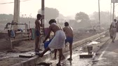 varanasi : VRINDAVAN, India - October 10, 2017: Street public shower for washing clothes and body wash. Poor people wash in the street. Vrindavan. India. For editorial use only. Stock Footage
