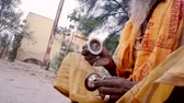 krishna : VRINDAVAN, India - October 10, 2017: Old man hobo with a big beard playing a small musical instrument. Vrindavan. India. For editorial use only.